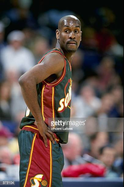 Gary Payton of the Seattle Supersonics looks over his shoulder during the game against the Golden State Warriors at the Oakland Coliseum Arena in...