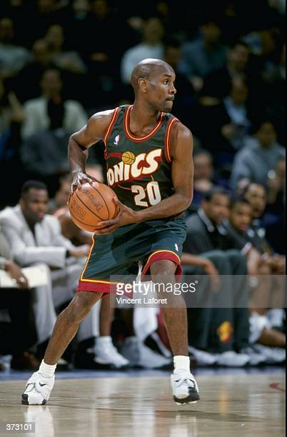 Gary Payton of the Seattle Supersonics looks to move during the game against the Golden State Warriors at the Oakland Coliseum Arena in Oakland...
