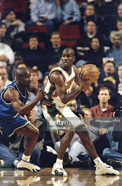 Gary Payton of the Seattle Supersonics looks to pass during the game against the Dallas Mavericks at the Key Arena in Seattle Washington The Sonics...