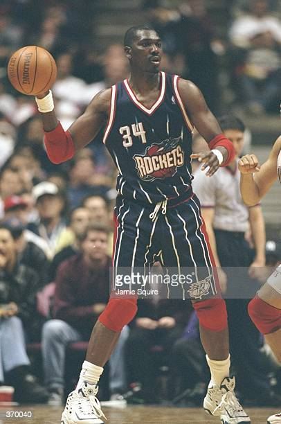 Hakeem Olajuwon of the Houston Rockets in action during the game against the New Jersey Nets at the Continental Airlines Arena in East Rutherford,...