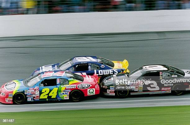 Jeff Gordon leads Dale Earnhardt and Mike Skinner during the NASCAR Daytona 500 at the Daytona International Speedway in Daytona, Florida.