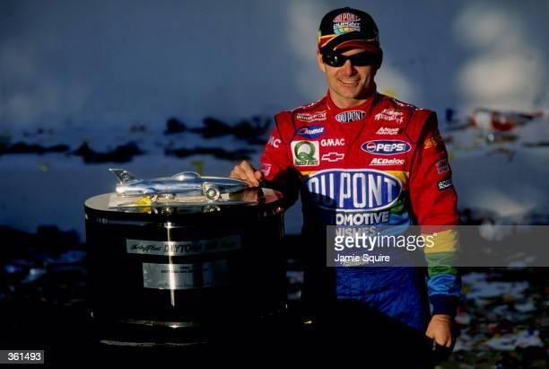 Jeff Gordon poses with the trophy after winning the NASCAR Daytona 500 at the Daytona International Speedway in Daytona, Florida. Mandatory Credit:...