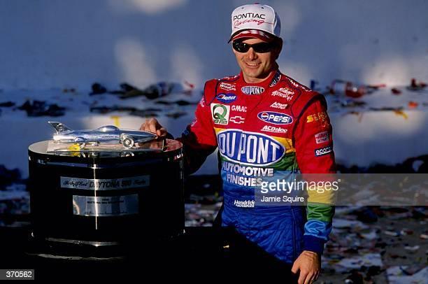 Jeff Gordon stands with his trophy after winning the Daytona 500 at the Daytona International Speedway in Daytona, Florida. Mandatory Credit: Jamie...