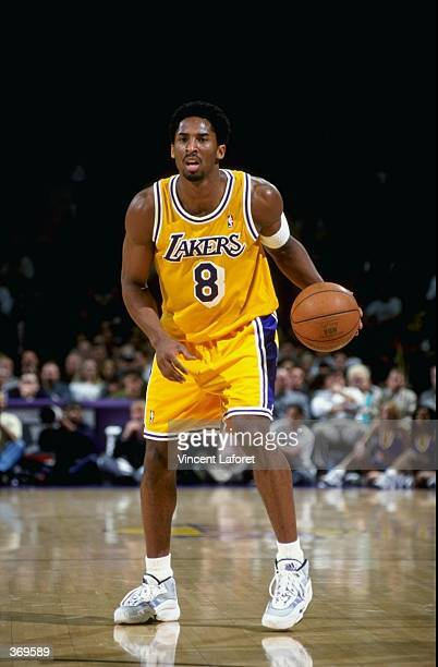 Kobe Bryant of the Los Angeles Lakers dribbles the ball during the game against the Dallas Mavericks at the Great Western Forum in Inglewood...