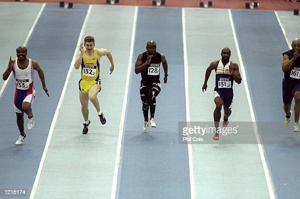 Kriss Akabusi Brian Whittle Ade Mafe Derek Redmond and Greg Fosterrun the 60m at the 1999 Ricoh Indoor Tour Bupa Indoor Grand Prix at the National...