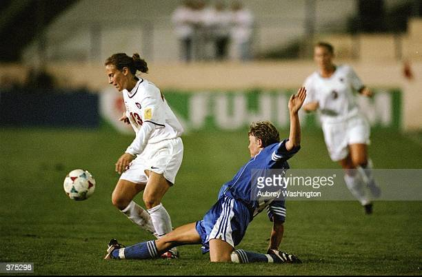 Kristine Lilly of Team USA takes the ball during the Womens World Cup game against the FIFA Allstars at the Spartan Stadium in San Jose California...
