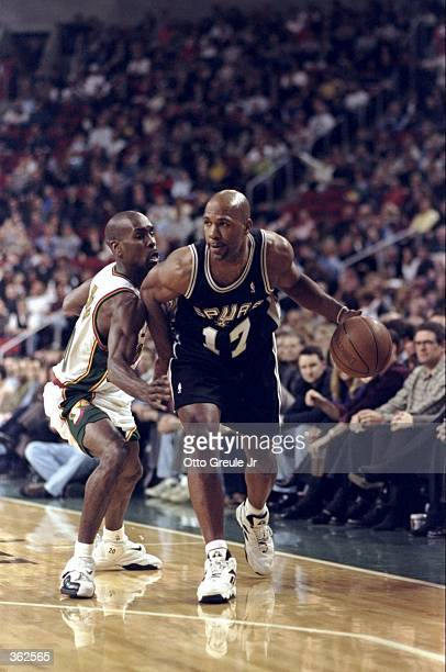Mario Elie of the San Antonio Spur dribbling the ball while being gaurded by Gary Payton during the game against the Seattle SuperSonics at the Key...