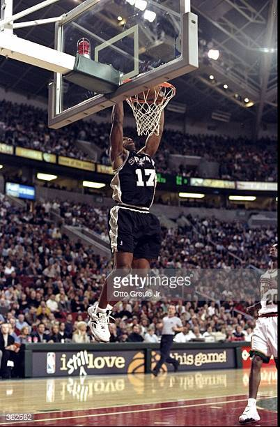 Mario Elie of the San Antonio Spur dunking the ball on a fast break during the game against the Seattle SuperSonics at the Key Arena in Seattle...
