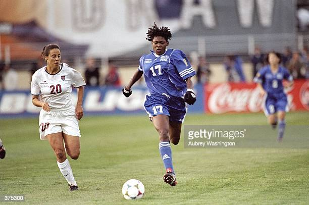 Mercy Akide of Nigeria and of the FIFA Allstars dribbles past Kate Sobrero of Team USA during the Women''s World Cup game at Spartan Stadium in San...
