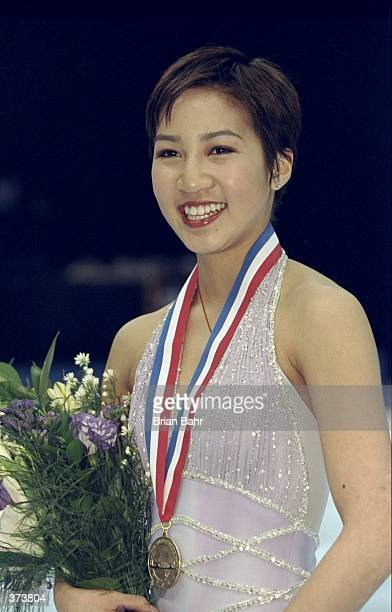 Michelle Kwan smiles as she wins the gols medal in the US Figure Skating Championships at the Delta Center in Salt Lake City, Utah. Mandatory Credit:...