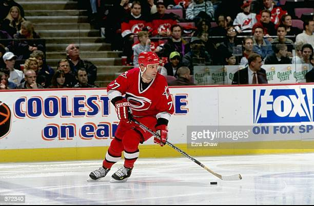 Paul Coffey of the Carolina Hurricanes controls the puck during the game against the New Jersey Devils at the Continental Airlines Arena in East...