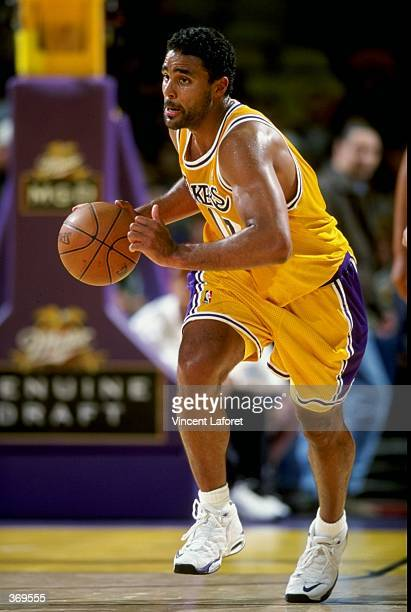 Rick Fox of the Los Angeles Lakers dribbles the ball during the game against the Charlotte Hornets at the Great Western Forum in Inglewood California...