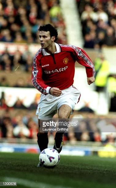 Ryan Giggs of Manchester United in action during an FA Carling Premiership match against Southampton in Manchester England The match finished in a 21...