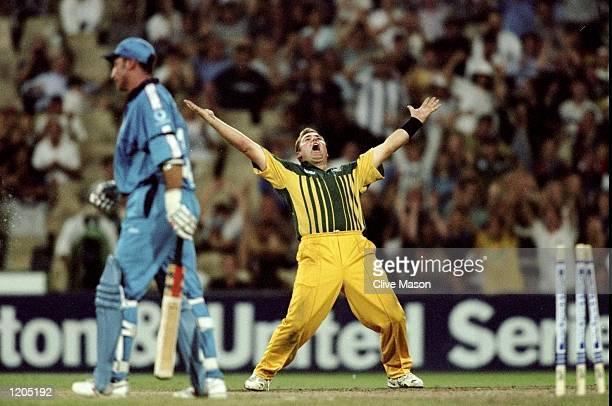 Shane Warne of Australia celebrates the wicket of Nasser Hussain of England in the first final of the Carlton and United One Day Series at the Sydney...