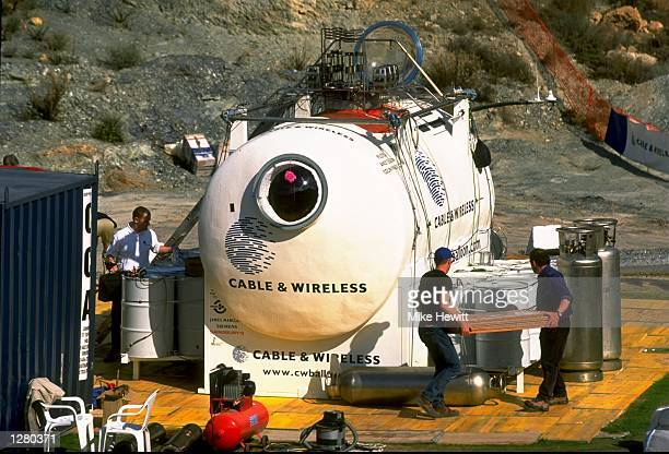 Support teams prepare the capsule ahead of the Cable and Wireless Round the World Balloon Voyage Launch in Almeria Spain Mandatory Credit Mike Hewitt...
