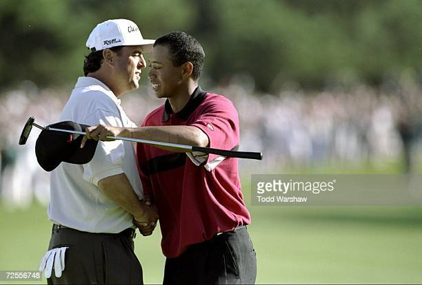Tiger Woods hugs Billy Ray Brown after Tiger wins the Buick Invitational at the Torrey Pines Golf Course in La Jolla, California. Mandatory Credit:...