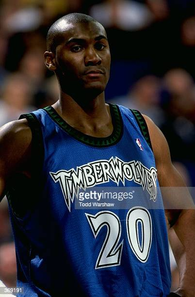 Tom Hammonds of the Minnesota Timberwolves looking on during the game against the Golden State Warriors at the Oakland Arena in Oakland California...