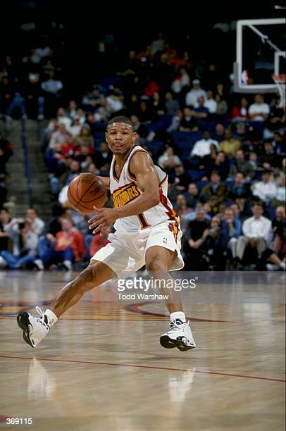 Tyrone Bogues of the Golden State Warriors in action during the game against the Minnesota Timberwolves at the Oakland Arena in Oakland California...