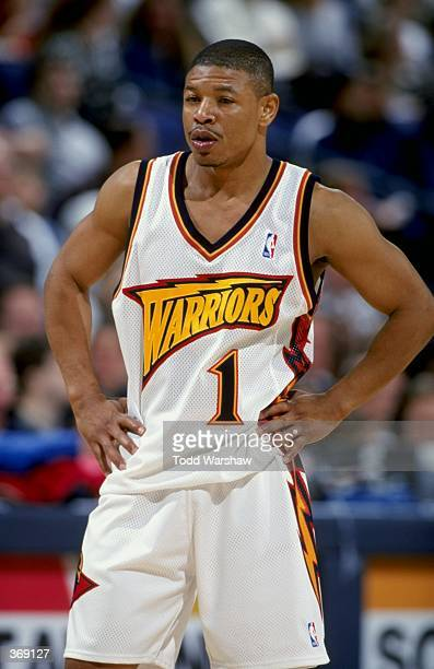 Tyrone Bogues of the Golden State Warriors looks on during the game against the Minnesota Timberwolves at the Oakland Arena in Oakland California The...