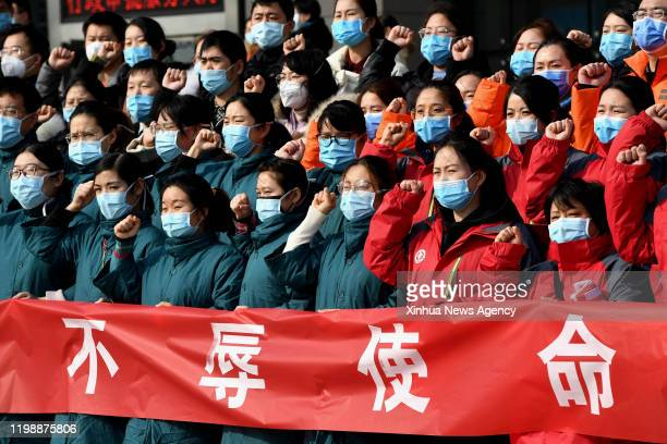 Feb. 2, 2020 -- Medical team members swear an oath before setting off for Wuhan in Hubei Province, in Zhengzhou, central China's Henan Province, Feb....