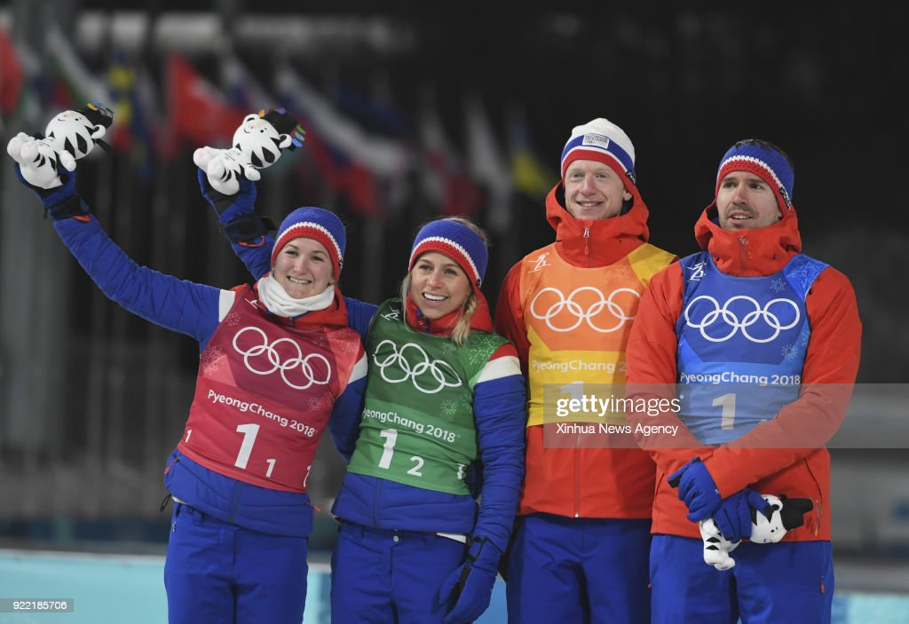 PYEONGCHANG, Feb. 20, 2018 -- Marte Olsbu, Tiril Eckhoff, Johannes Thingnes Boe and Emil Hegle Svendsen (L to R) of second-placed team Norway celebrate during venue ceremony of 2x6km women + 2x7.5km men mixed relay of biathlon at the 2018 PyeongChang Winter Olympic Games at Alpensia Biathlon Centre, PyeongChang, South Korea, Feb. 20, 2018.