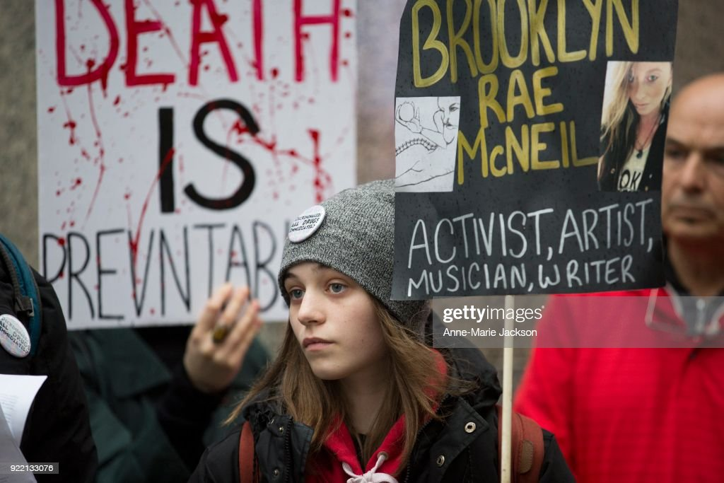 TORONTO, ON. Feb 20, 2018 - Olympia Trypis joins a group at King and York St. for National Day of Action regarding the overdose crisis. The group called for decriminalization and better harm-reduction services.