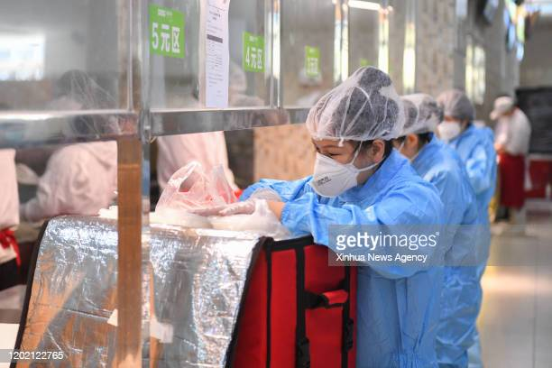 Feb. 20, 2020 -- Staff members of the dinning room package takeaway boxes at Sany Heavy Industry in Changsha, central China's Hunan Province, Feb....
