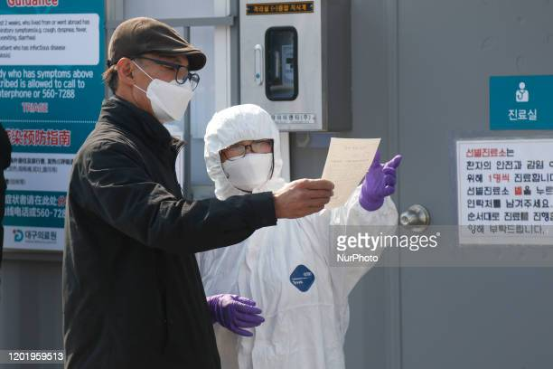 Feb 20, 2020-Daegu, South Korea- Hospital staff instruction to patience at medical center in Daegu, South Korea. South Korea reported 31 new cases of...