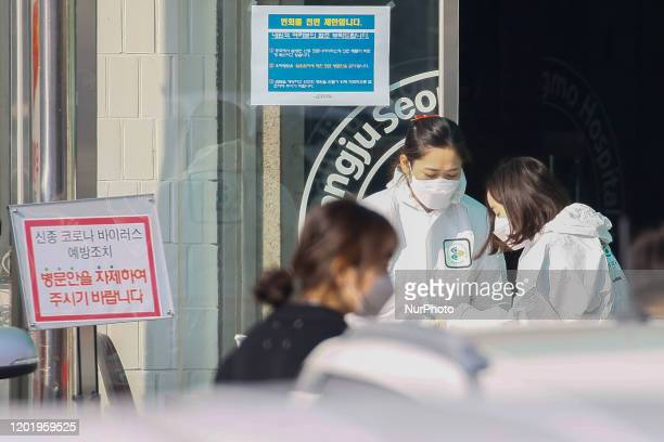Feb 20, 2020-Daegu, South Korea-Hospital Staff check patience temperature at medical center in Sangju, South Korea. South Korea reported 31 new cases...