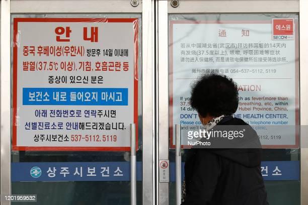 Feb 20, 2020-Daegu, South Korea-Visitor read to Corona virus warning at region health care office in Sangju, South Korea. South Korea reported 31 new...