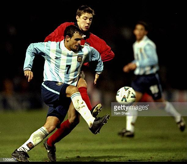 Alan Smith of England challenges Diego Govidi of Argentina in an international under 21's Friendly match the game was played at Craven Cottage in...
