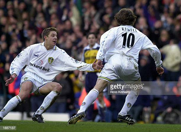 Alan Smith of Leeds runs to congratulate goalscorer Harry Kewell during the Leeds United v Tottenham Hotspur FA Carling Premiership match at Elland...
