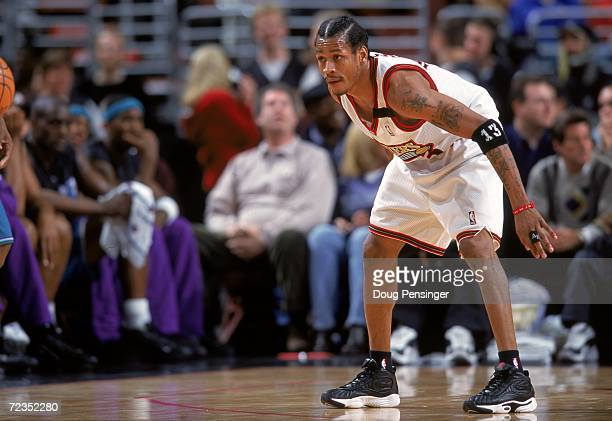 Allen Iverson of the Philadelphia 76ers is ready on the court during the game against the Charlotte Hornets at the First Union Center in Philadelphia...