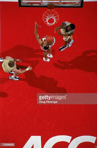 An overhead view of Lonny Baxter of the Maryland Terrapins as he leaps for the basket and is guarded by Clarence Moore of the Georgia Tech Yellow...