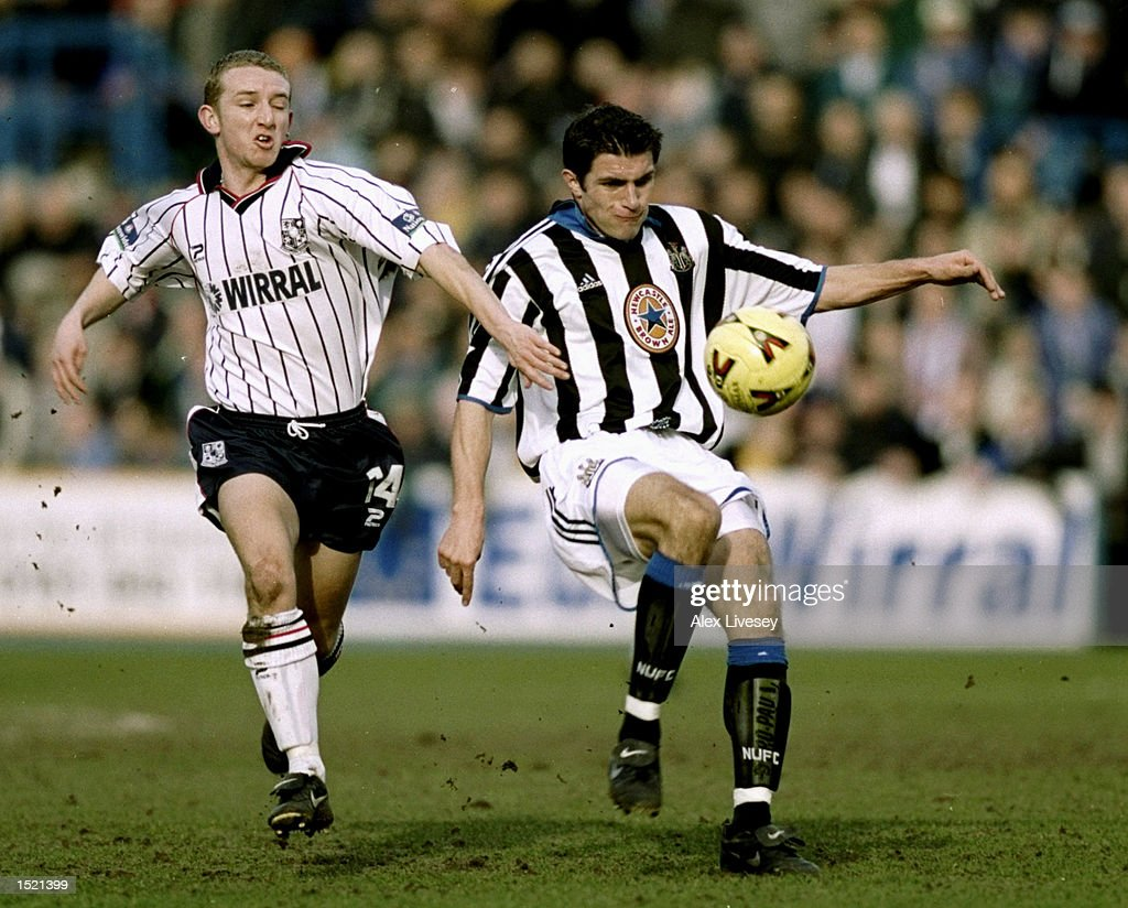 Andy Parkinson of Tranmere Rovers challenges Aaron Hughes of Newcastle United : News Photo