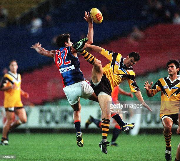 Barry Young#36 for Hawthorn contests for the ball against Andrew Embley for the West Coast Eagles during the match between Hawthorn and the West...