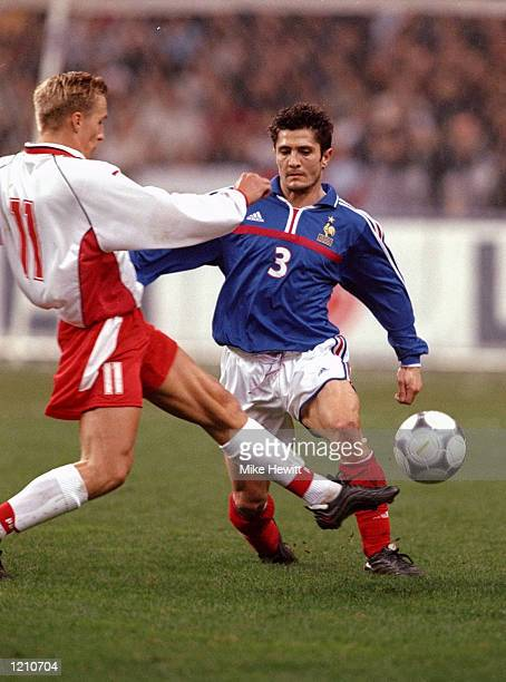 Bixente Lizarazu of France is challenged by Barbosz Karwan of Poland during the International Friendly at the Stade de France in Paris France won 10...