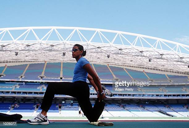 Cathy Freeman of Australia inspects the track of Stadium Australia during the Optus Media Conference at Stadium Australia Sydney Australia Mandatory...