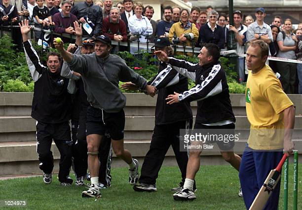 Chris Cairns of New Zealand celebrates a catch to dismiss Jeff Wilson a member of the New Zealand All Blacks rugby team during a friendly cricket...