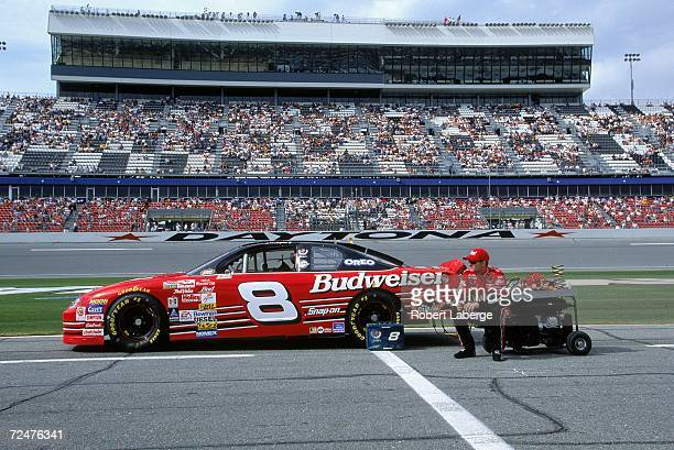 Dale Earnhardt Jr sits next to his car during Daytona Speedweeks at the Daytona International Speedway in Daytona Beach Florida Mandatory Credit...