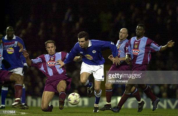 Gareth Southgate of Villa tries to tackle Muzzy Izzet of Leicester during the Leicester City v Aston Villa Worthington Cup semifinal second leg at...
