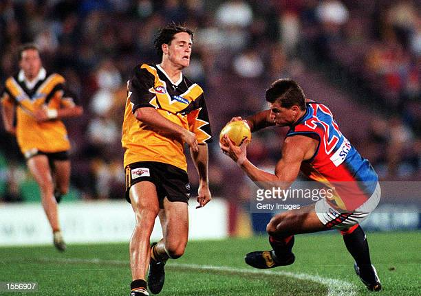 Glen Jakovich for the West Coast Eagles marks the ball in front of Trent Croad of Hawthorn during the match between Hawthorn and West Coast in the...
