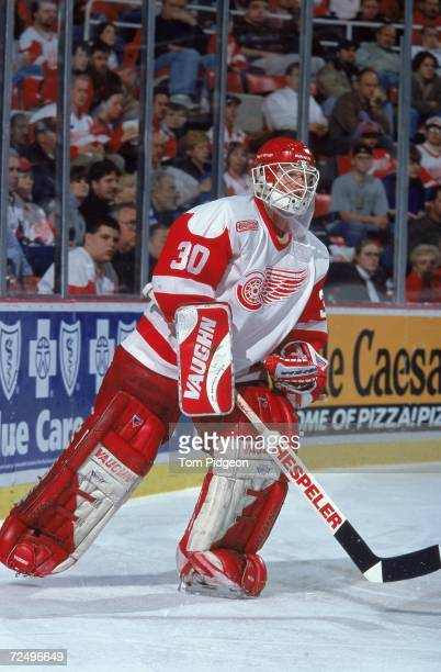 Goal Keeper Chris Osgood of the Detroit Red Wings skates on the ice during a game against the Vancouver Canucks at the Joe Louis Arena in Detroit...