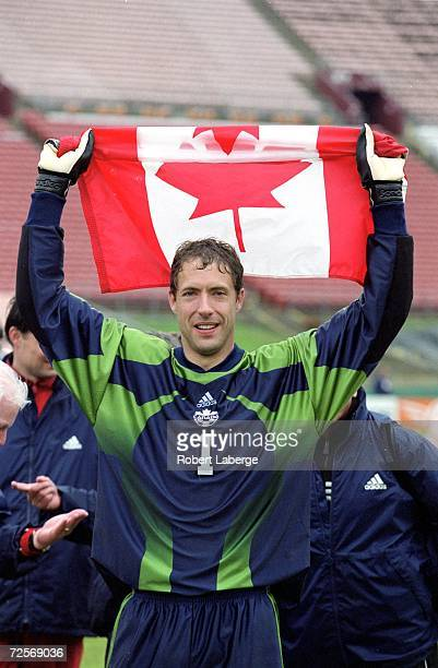 Goalie Craig Forrest of the Team Canada celebrates as he holds up the Canadian flag after the FC Gold Cup 2000 Game against Team Columbia at the Los...