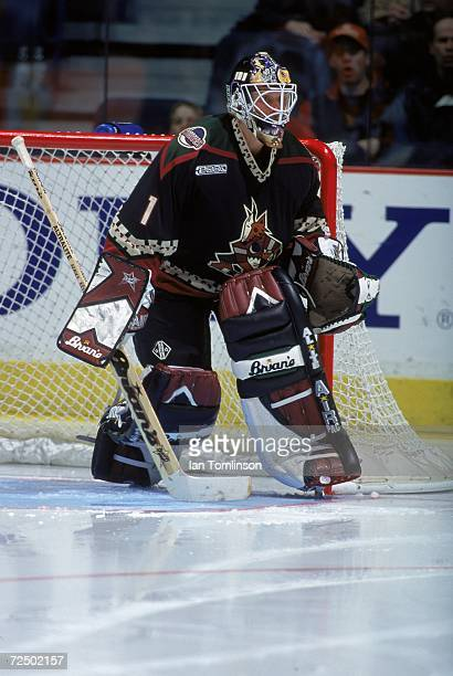 Goalie Sean Burke of the Phoenix Coyotes moves to guard the goal during a game against the Calgary Flames at the Canadian Airlines SaddleDome in...
