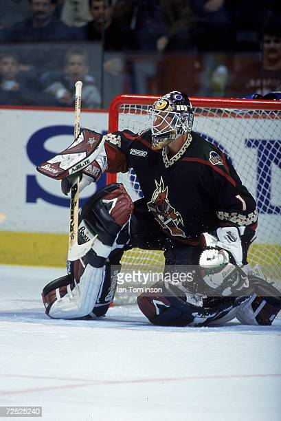 Goalie Sean Burke of the Phoenix Coyotes moves to stop the puck during a game against the Calgary Flames at the Canadian Airlines SaddleDome in...