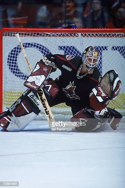 Goalie Sean Burke of the Phoenix Coyotes stops a shot to the goal during the game against the Calgary Flames at the Canadian Airlines Saddledome in...