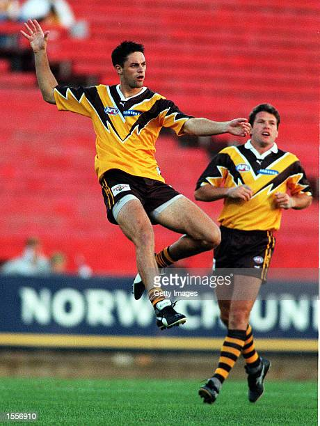 Jade Rawlings#20 for Hawthorn kicks the ball in front of his teammate Barry Young#36 during the match between Hawthorn and the West Coast Eagles in...