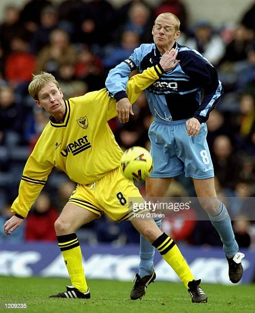 Keith Ryan of Wycombe Wanderers battles with Paul Tait of Oxford United in the Nationwide Division Two League game the match was played at Adams Park...