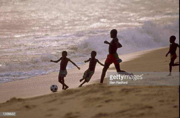 Kids playing football on the beach during the African Nations Cup in Nigeria Mandatory Credit Ben Radford /Allsport